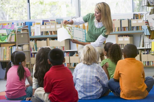 teacher reading to children in library, storytime